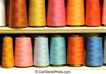 Group of sewing threads in two rows