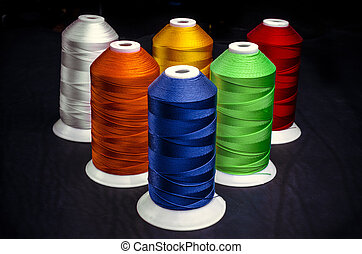 Sewing threads multicolored on a black background