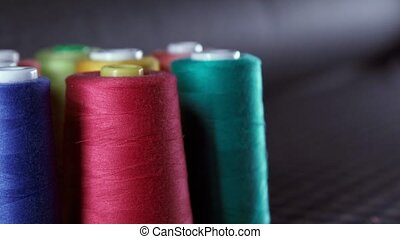 Sewing Threads On Spool. Colorful spools of thread in textile factory.