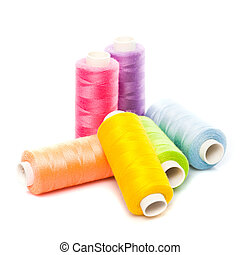 Sewing threads - Sewing multicolored threads isolated on ...