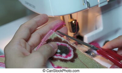 Sewing Tightening Serger Threads - Close up shot of someone...