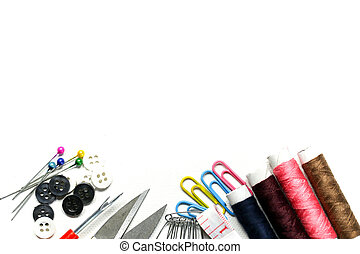 Sewing tools and accesories on white background.