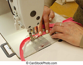 Zipper sewing on the sewing equipment (close up)