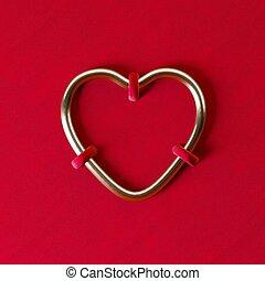 sewn heart on red velvet fabric. Valentine's day minimal concept.