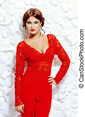sex appeal - Seductive sensual woman in elegant red suit on...