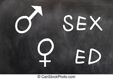 Sex education with gender symbols written with chalk on a...