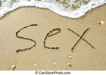 sex on the beach - word sex written on the sand of a beach