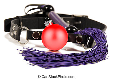 Sex toys - Ball gag and whip, isolated on white background....