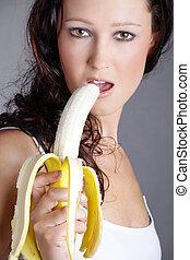 sexo, mujer que come, plátano, vende