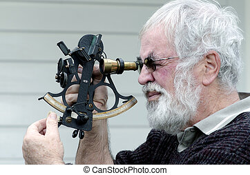 Sextant - Sea Navigation Instrument - Navigator on bridge of...