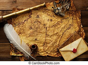 Sextant, spyglass and envelope on vintage map over wooden ...