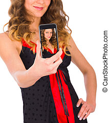 Pretty girl sexting with mobile phone - studio shot.