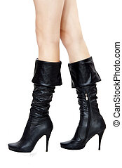 Sexual black boots and long legs