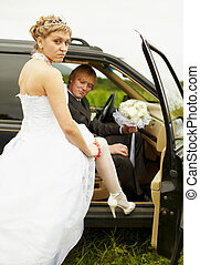 Sexual bride and groom in car