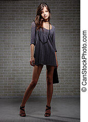 Sexual brunette fashion model  in knitted dress
