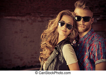 sexual couple - Couple of young people in jeans clothes ...