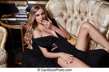Sexual elegant woman in a black dress.