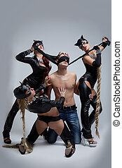 Sexual games of three women and man - Full length portrait...