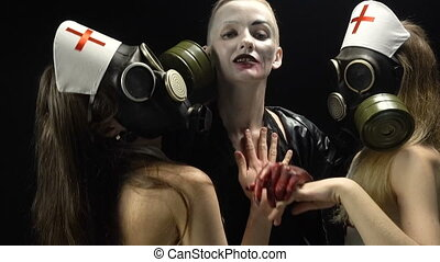 Sexual girls in gas mask and woman in black - Footage of...