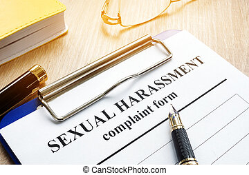 Sexual harassment complaint form on a desk.