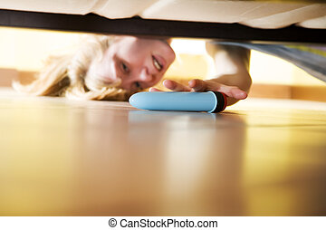 sexual issues - woman looking for her dildo under the bed
