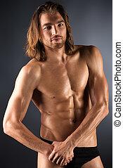 muscular nude - Sexual muscular nude man posing over dark...