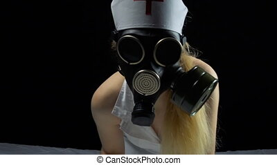 Sexual nurse girl with gas mask in bed - Footage of sexual...
