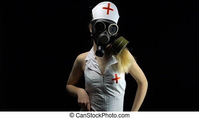 Sexual nurse in gas mask - Footage of sexual young nurse on...