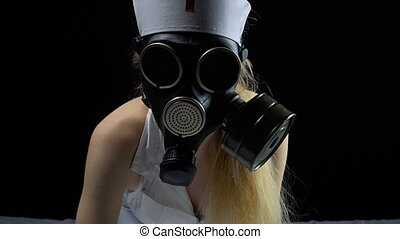 Sexual nurse with gas mask in bed - Footage of sexual young...