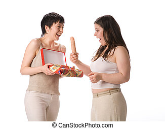 Sexual surprise. Two girl with vibrator on white background