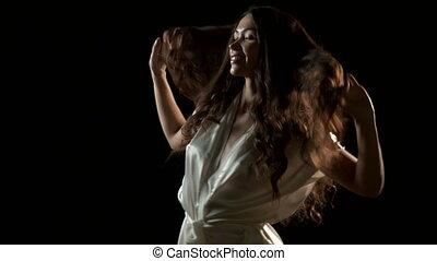 Sexual woman in silk robe dancing - Sexy woman in silk robe...