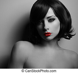 Sexual woman with black short hair and red lipstick looking...