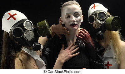 Sexual women in gas mask and woman in black