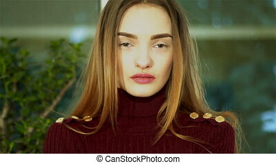 sexual young lady with nice make up looking at the camera at home