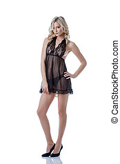 Sexual young model advertises black lacy negligee, isolated...