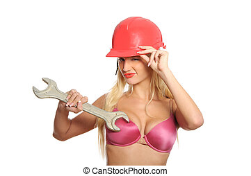 Sexual young woman with wrench