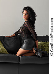 Sexy african american glamour girl leather couch