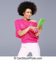 Sexy African American woman with a tablet