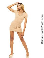 Sexy african woman in beige dress