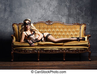Sexy and beautiful woman in erotic lingerie and stockings...
