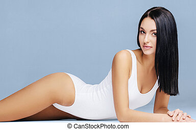 Sexy and beautiful woman in underwear. Beautiful and healthy girl with young and fit body posing in underwear. Sport, fitness, diet, nutrition and health concept.
