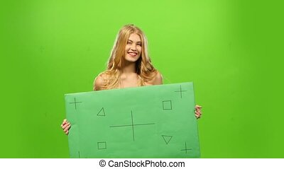 sexy and smiling blonde woman, green screen, blank sign