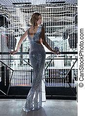 Sexy anf beauty woman posing in kight of nightclub