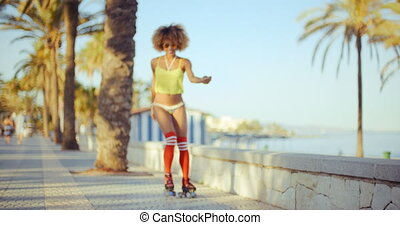 Sexy Angle of Roller Skate Girl Riding on Tropical Beach...