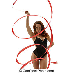 Sexy artistic gymnast posing with ribbon