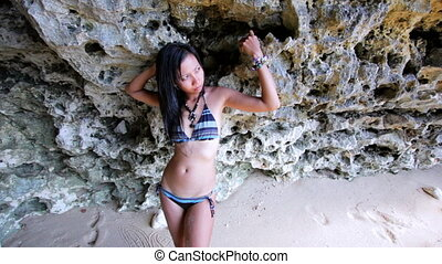 Sexy Asian Girl Lean Against Rock