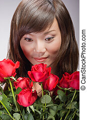 sexy asian girl smelling roses