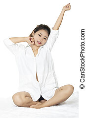 Sexy Asian woman wearing a white shirt on white backround