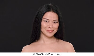 sexy Asian woman with beauty face and perfect skin - Half...