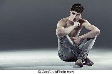 sexy, atleet, pose, jonge man